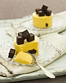 Mango mousse with brownie cubes