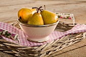 Pears in a ceramic bowl on a tray