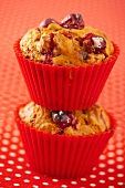 Two cranberry muffins one on top of each other