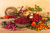 An arrangement of rosehips and barberries
