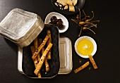 Salted bread sticks, olives and olive oil