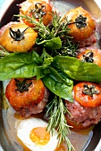 Tomatoes stuffed with minced meat with basil and egg