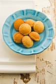 Honey and ginger madeleines on a blue plate