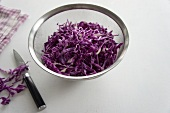 Chopped red cabbage in a sieve