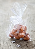 Fresh marzipan potatoes in a gift bag