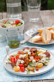 A chanterelle mushroom, tomato and courgette salad with feta cheese