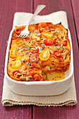 Courgette and tomato lasagne with sunflower seeds