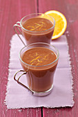 Hot chocolate in glass cups with orange zest