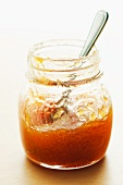 Spoon In a Half Empty Jar of Apricot Preserves