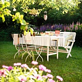 A table laid in a summery garden