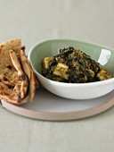 Bowl of Saag Paneer (Paneer Cheese with Spinach) with Flat Bread