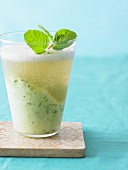 Honeydew Drink with Mint Garnish in a Glass