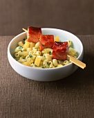 Glazed ham skewers on macaroni