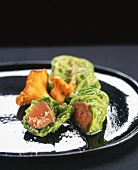 Foie gras in Savoy cabbage leaves with chanterelles