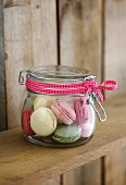 Colourful macaroons in preserving jar as a gift