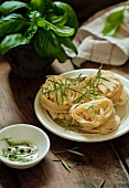 Uncooked tagliatelle with rosemary sprigs