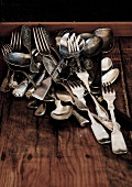 Assorted flatware on a wooden background