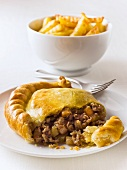 Beef pasty with french fries (England)