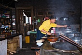A cook in a Burmese kitchen