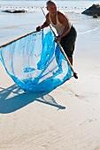A Burman fishing for mini prawns