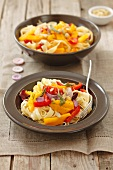 Tagliatelle with pumpkin, pepper and red onions