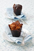 An apple muffin and a chocolate muffin