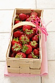 Fresh strawberries in a woodchip basket