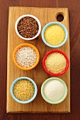 Bowls of buck wheat, polenta, barley, couscous, bulgur and semolina