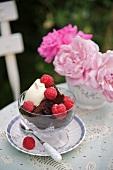 Chocolate fudge cake with raspberries and cream