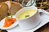 Pumpkin soup, smoked salmon and bread