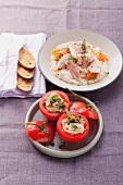 Smoked trout on horseradish quark and tomatoes stuffed with tuna fish and capers