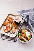 Mixed oven roasted vegetables with herb quark and baked potatoes with radish quard