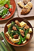 Bowl of Pasta with Broccoli Rabe and Sausage; Salad and Bread