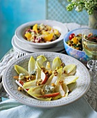 Chicory salad, with tabbouleh with oranges and bean salad in the background