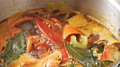 Lobster stock simmering in a pan