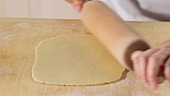 Rolling out shortbread dough with a rolling pin