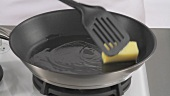 Melting butter in a frying pan