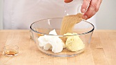 Putting ingredients for biscuit dough into a mixing bowl