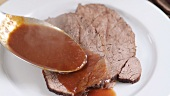 Arranging roast beef with jus