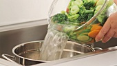 Draining blanched vegetables
