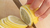 Thinly slicing a lemon