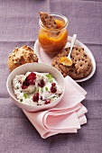 Cream cheese with cranberries and basil and apricot preserves with crisp bread