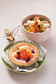 Cantaloupe with cream cheese and fruit salad with Quark and almond brittle