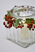 Tea light holder made from jar decorated with berries & leaves