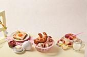 Sunday brunch for children (fried egg, croissants and bread, cornflakes)