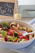 Pasta shells with tomato and courgette