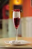 Raspberry dessert in champagne glass