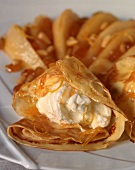Crepes with cream-cream cheese filling, orange caramel and pine nuts
