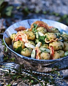 Potato salad with pancetta, spring onions and herbs