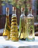 Assorted varieties of vinegar in bottles with corks
